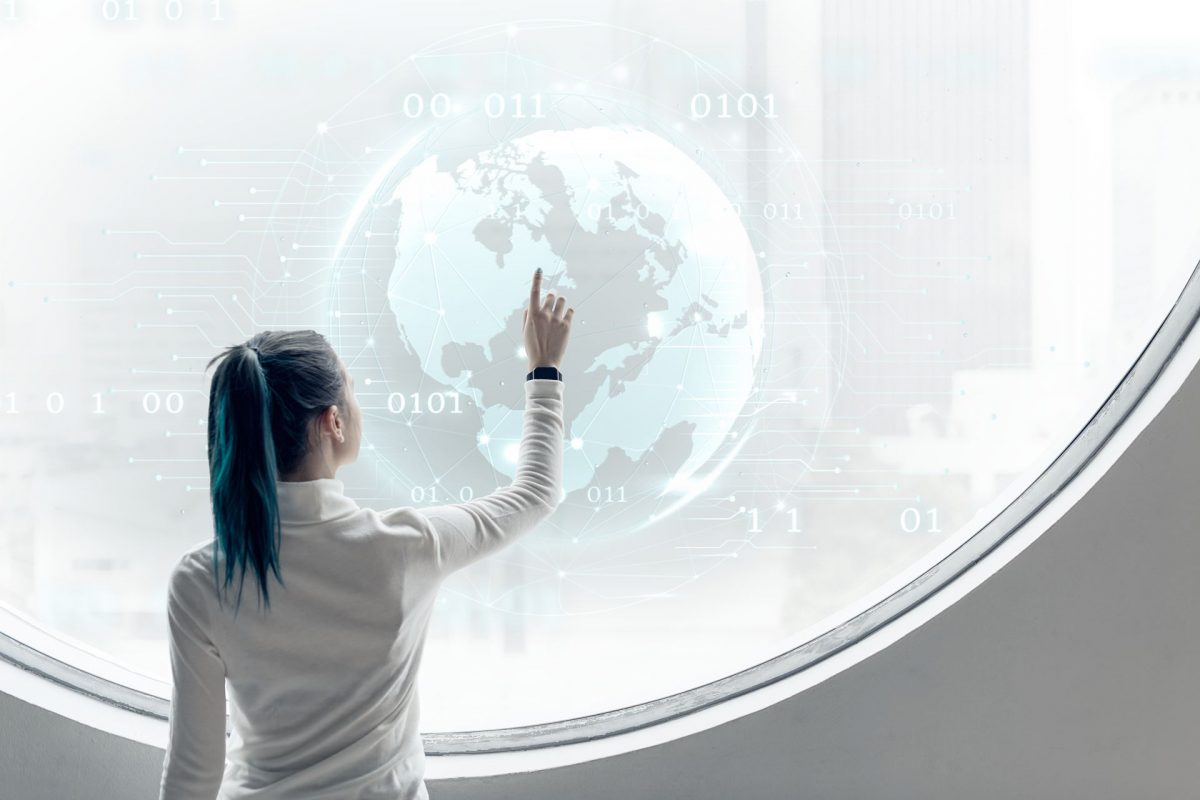 Researcher spinning a globe on a round screen